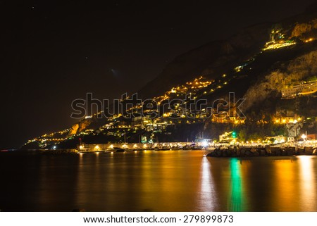 Night view of Amalfi on coast line of Mediterranean sea, Italy - stock photo