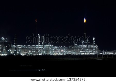 Night View of an Oil Refinery Plant. Horizontal shot - stock photo