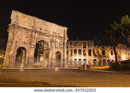 Night view of Arch of Constantine and colosseum in Rome, Italy - stock photo