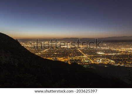 Night view of Burbank and North Hollywood in Los Angeles's San Fernando Valley.   - stock photo