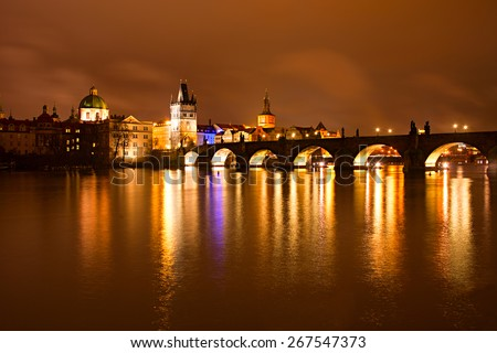 Night view of Charles bridge and Church of St. Francis. Prague, Czech Republic - stock photo
