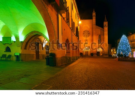 Night view of Christmas Tree on town square and San Lorenzo cathedral on background in Alba, Piedmont, Northern Italy. - stock photo