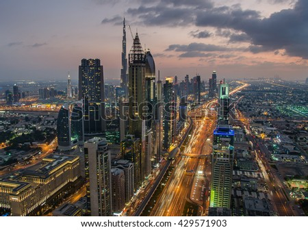 Night view of Downtown Dubai with Dubai Fountain and skyscrapers from the tallest building in the world, Burj Khalifa, at 828m - stock photo