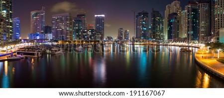Night view of Dubai Marina, UAE. Dubai Marina is an artificial 3 km canal carved along the Persian Gulf shoreline.  - stock photo