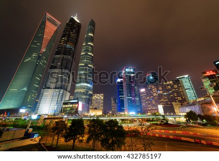 Night view of famous skyscrapers and other modern buildings in the Pudong New District (Lujiazui) of Shanghai, China. The Shanghai World Financial Center, the Jin Mao Tower and the Shanghai Tower. - stock photo