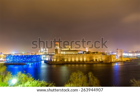 Night view of Fort Saint-Jean and Cathedral in Marseille, France - stock photo