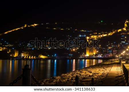 Night view of harbor, fortress and ancient shipyard in Alanya, Turkey - stock photo