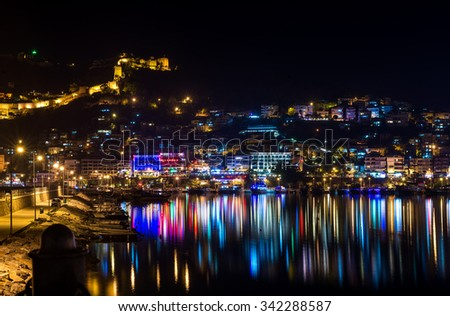 Night view of harbour, fortress and night lights in Alanya, Turkey - stock photo
