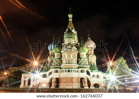 Night view of Intercession Cathedral St. Basil's  through rays of lamp on Red square, Moscow, Russia - stock photo