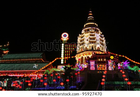 Night view of Kek Lok Si buddhist complex pagoda illuminated with colorful annual decorative festival lightings for Chinese New Year, in Air Itam, Penang, Malaysia. - stock photo