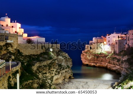 "Night  view of little village ""Polignano a mare"" and it's bay in  south Italy - stock photo"