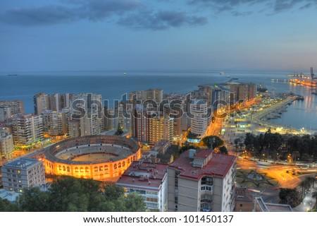 "Night view of Malaga city. Malaga's bullring ""La Malagueta"" lies in the heart of the city. - stock photo"