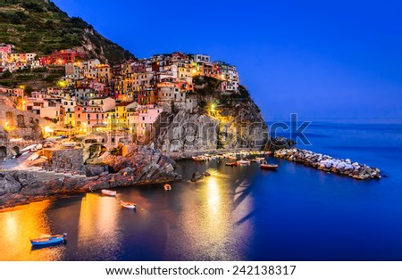 Night view of Manarola, one of the five villages of the Cinque Terre on Italy mediterranean coast. - stock photo