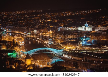Night view of old town of Tbilisi. Tiflis is the largest city of Georgia, lying on the banks of Mtkvari River - stock photo