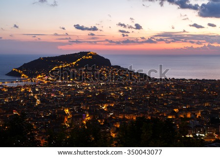 Night view of peninsula in Antalya, Alanya Castle with lighting in blue hours. - stock photo