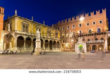 Night view of Piazza dei Signori with statue of Dante in Verona. Italy - stock photo