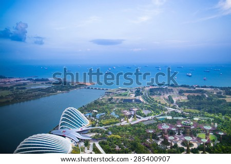 Night view of Singapore city center. Skyline of central districts. Modern architecture in Asia. Financial buildings, skyscrapers at night. Waterfront and the sea. Gardens and bay. - stock photo