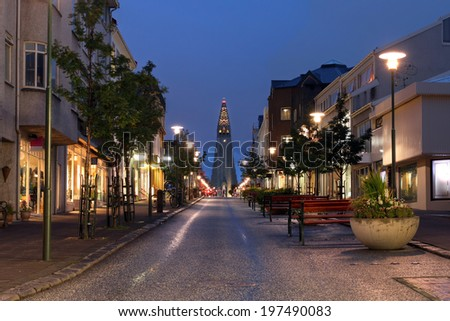 Night view of Skolavordustigur street leading to the Hallgrimskirkja Church, one of the landmarks of Reykjavik, the capital city of Iceland. - stock photo