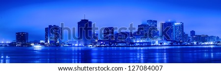 Night view of Skyline of New Orleans as seen from the MIssissippi river - stock photo