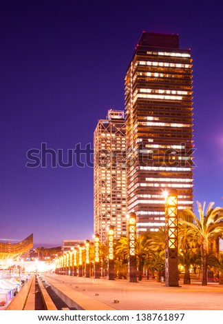 night view of skyscraper in Port Olimpic - center of nightlife at Barcelona, Spain - stock photo