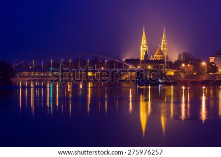 Night view of Szeged city from the other side of Tisza River-Hungary - stock photo