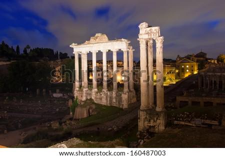 Night view of Temple of Saturn. Forum Romanum in Rome, Italy - stock photo