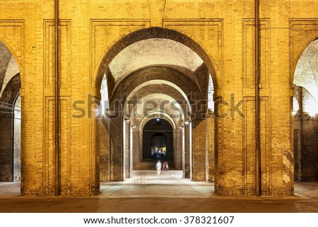 Night view of the arches of historic Pilotta palace in Parma, Italy. - stock photo