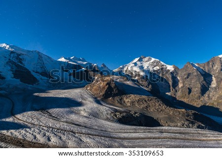 Night view of the Bernina massive and Morteratsch glacier in moon light from the mountain house of Diavolezza, in Engadine area of Switzerland. - stock photo