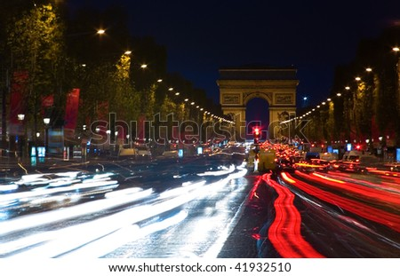 Night view of the Champs-Elysees and the Arc de Triomphe in Paris, France - stock photo