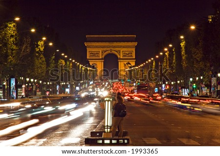 Night view of the Champs-Elysees avenue leading to the Arc de Triomphe - Paris, France - stock photo