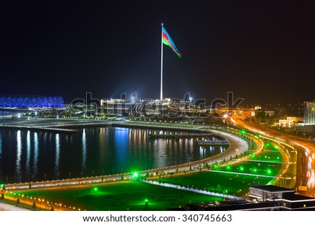 Night view of the city of Baku. The largest flag in the world - stock photo