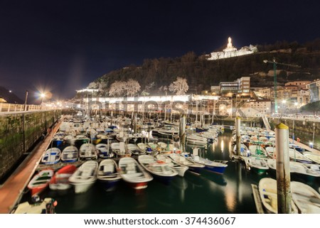 Night view of the harbor in San Sebastian, Basque Country, Spain - stock photo