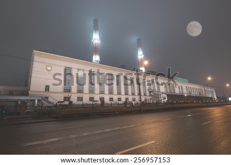 Night view of the industrial building by the road. - stock photo