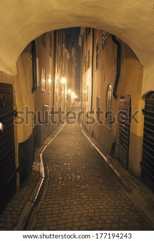 Night view of the old narrow street. Stockholm, Sweden. Effect retro film - stock photo