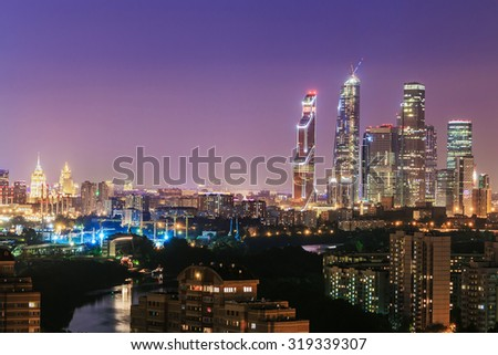 Night view of the residential and financial development of Moscow. Focus on skyscrapers - stock photo