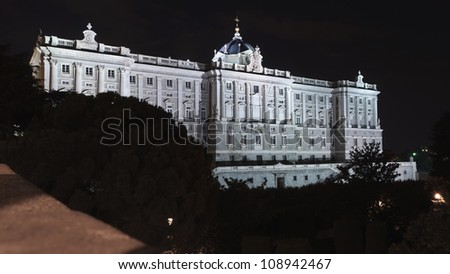 Night view of the right wing of the royal palace in Madrid, Spain - stock photo