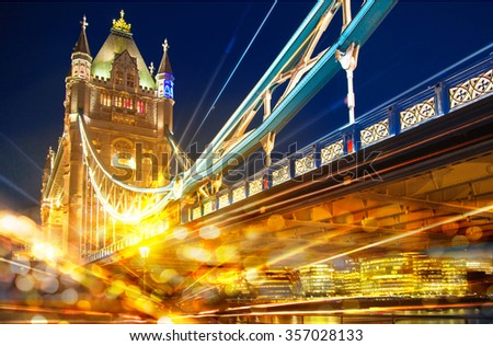 Night view of Tower bridge with traffic lights reflections - stock photo