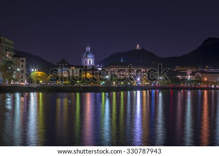 Night view of town Como and the lake Como in Italy - stock photo