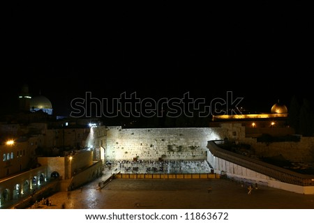 night view of Wailing Wall, Jerusalem with two mosques at sides - stock photo