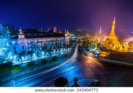 Night view of Yangon cityscape with famous Buddhist shrine Sule pagoda. Myanmar (Burma) - stock photo