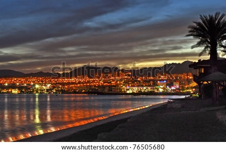 Night view on Eilat city and gulf of Aqaba - stock photo
