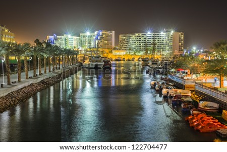 Night view on marina and resort hotels of Eilat city, Israel - stock photo