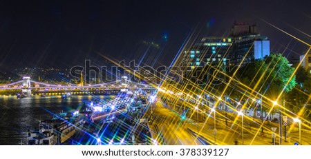 Night view on Szechenyi Chain Bridge over Danube river  and  Budapest streets at night. Hungary. Cross Filter Effect  - stock photo