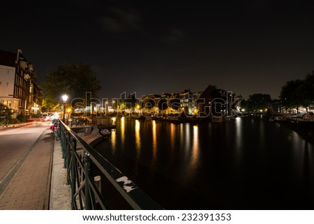 Night view on the Amsterdam canal at night in Holland - stock photo