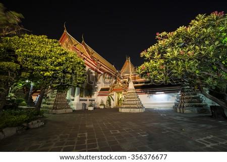 Night view on Wat Po, The Temple of reclining buddha, Bangkok, Thailand. - stock photo