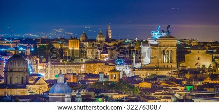 night view over rome taken from the top of gianicolo hill. the most interesting monument on the horizon is snow white vittoriano building with distinct statue on top. - stock photo