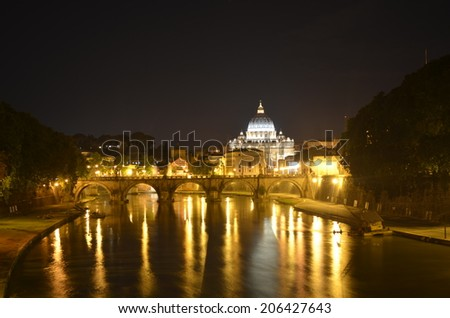 Night view over tiber river, saint peters basiica and ponte sant angelo in rome - stock photo