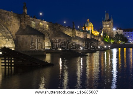 Night view to Charles bridge via Vltava river. - stock photo