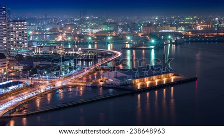 Night view Yokohama Bay. showing the Yokohama Bay and Tokyo city at the far end - stock photo