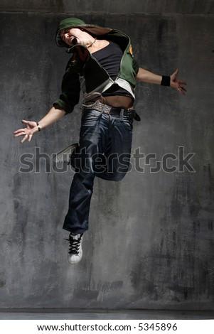 Nightclub dancer posing on a dark background - stock photo